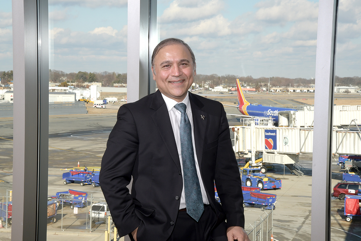 """AIMING HIGH: Iftikhar Ahmad, CEO and president of R.I. Airport Corp., which oversees T.F. Green Airport, says the goal is to reach 6 million passengers annually to have Green be """"a strong 'medium' hub"""" and to """"connect Rhode Island to the rest of the world in a meaningful way."""" / PBN PHOTO/MIKE SKORSKI"""
