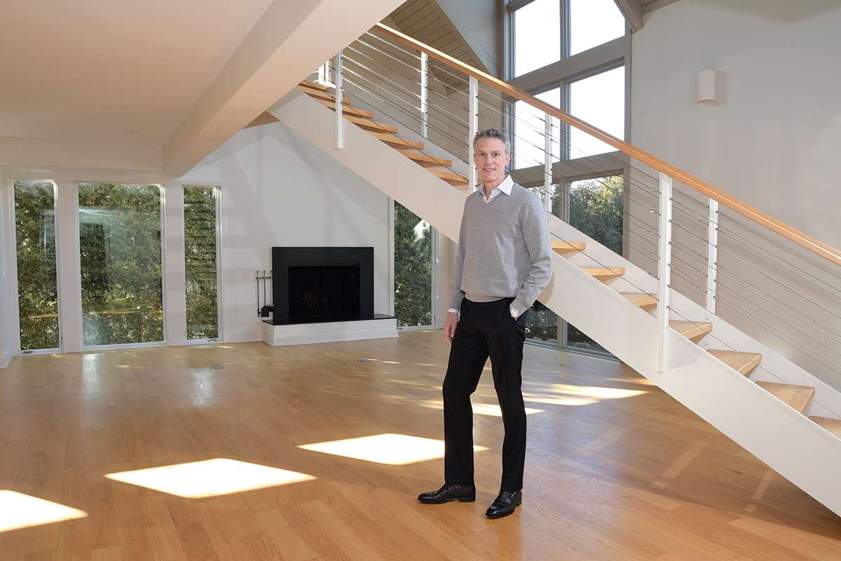 MIDCENTURY MODERN: Jim DeRentis, a sales associate with Residential Properties, has sold this house at 51 Prospect St. in the College Hill section of Providence three times. The midcentury modern was originally built in the early 1980s and has had several renovations since. / PBN PHOTO/MIKE SKORSKI