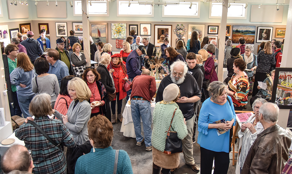 """ART EXHIBIT: Attendees converse during the opening reception for the """"Anything Goes"""" exhibit at the Wickford Art Association in North Kingstown in January. On Feb. 7, the association will hold an opening reception for its next juried exhibit, which will run until March 1. / COURTESY OF WICKFORD ART ASSOCIATION/MIKE MASI"""