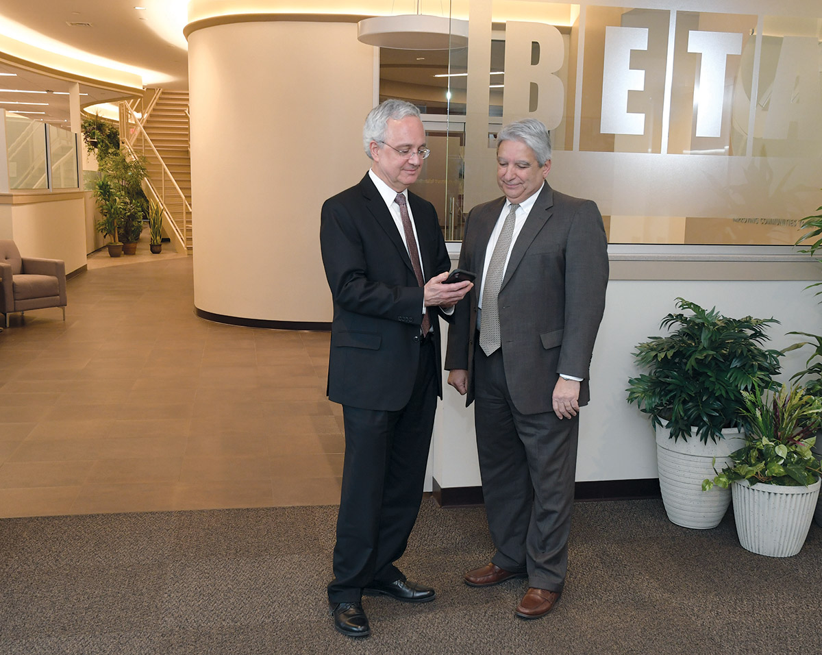 LEADERSHIP CHANGE: Joseph D'Alesio, left, president and chief operating officer, and Frank Romeo, CEO, recently took on new roles at BETA Group in Lincoln. The planning firm has lent engineering, construction, design and other services to numerous infrastructure projects throughout Rhode Island and New England. / PBN PHOTO/MIKE SKORSKI