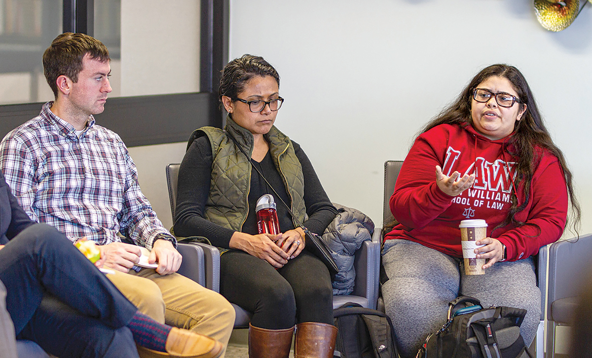 SPEAKING UP: Law student Shahily Negron-Falcon, right, president of the Multi-Cultural Law Students Association at Roger Williams University School of Law, takes part in an equity roundtable discussion on environmental justice at RWU in Bristol on Feb. 19. At left are fellow RWU law students Troy Lange, RWU law editorial board member, and Stephanie Gonzalez. / COURTESY ROGER WILLIAMS UNIVERSITY SCHOOL OF LAW/JOSHUA GRAB