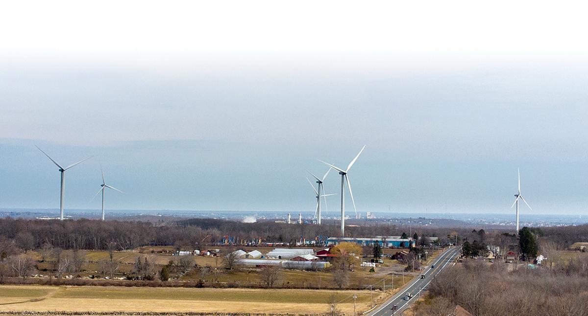 LARGEST WIND FARM: Green Development owns the turbines that make up Rhode Island's largest wind farm, the $100 million, seven-turbine project in Johnston, which generates 21 megawatts. / PBN PHOTO/PAMELA BHATIA