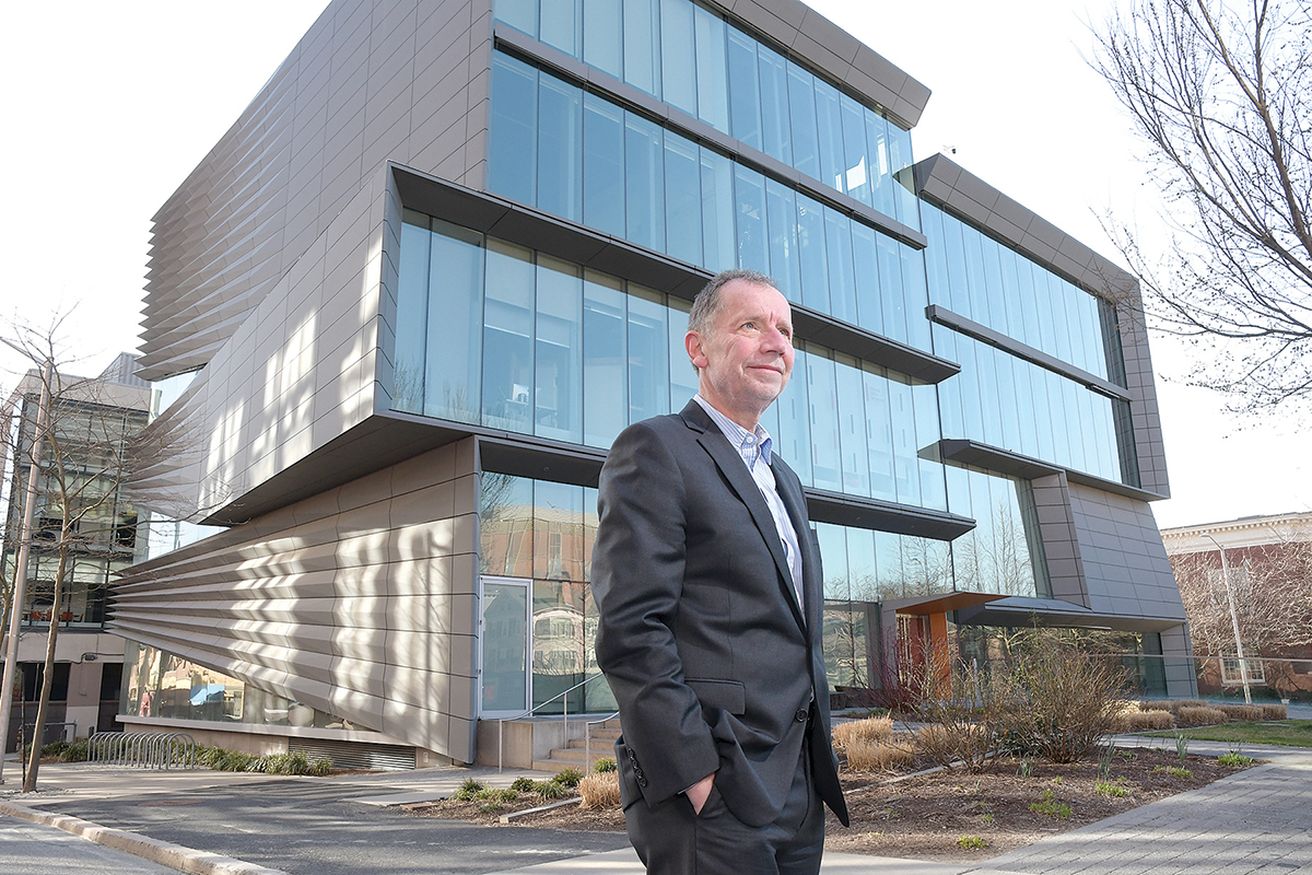 SHINING EXAMPLE: Dietrich Neumann, a professor of the history of modern architecture at Brown University, stands in front of the university's Granoff Center for the Creative Arts, which he says is one of the best modern buildings in Providence. / PBN PHOTO/MIKE SKORSKI