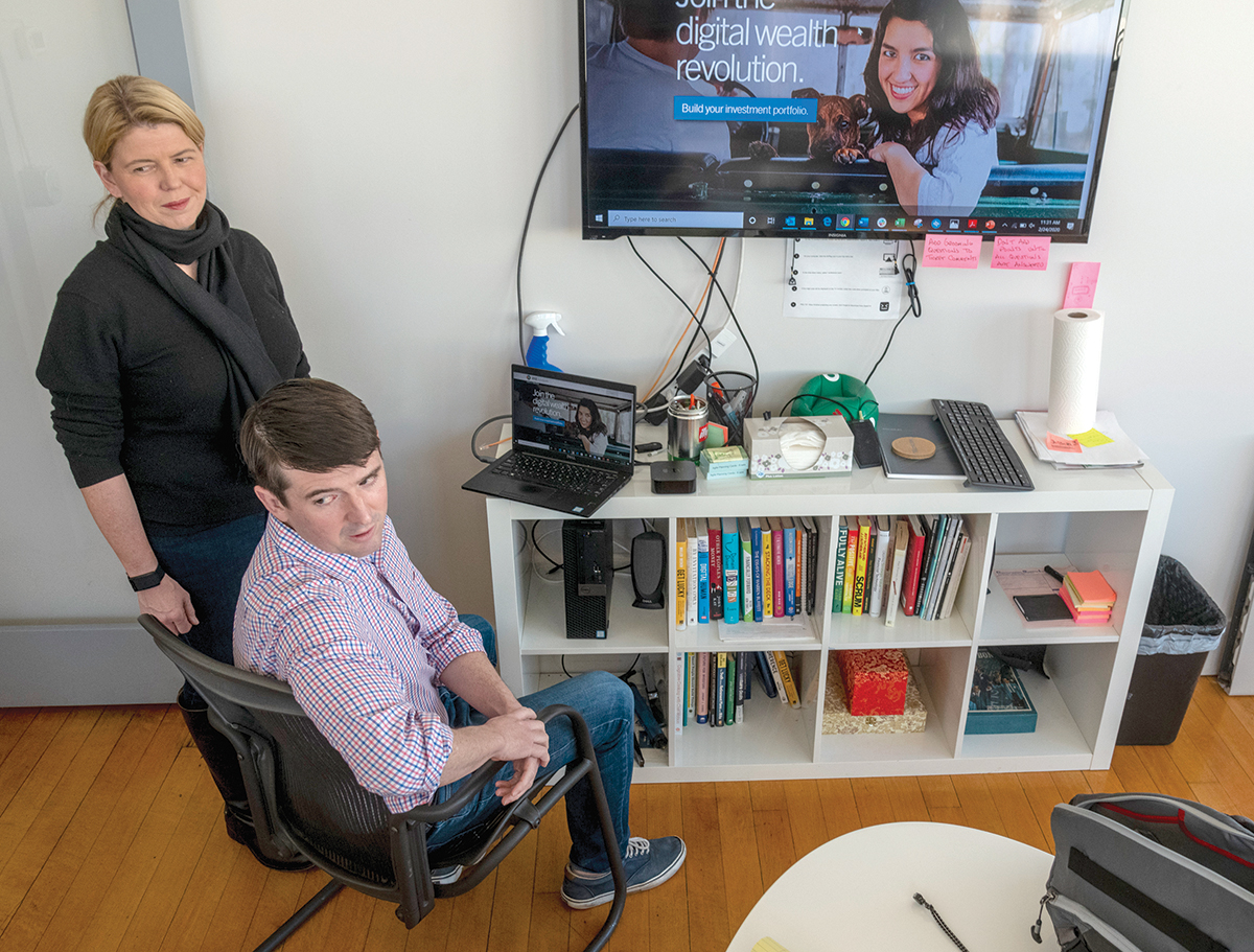 """CREATIVE CAPITAL: Margaret Hartigan, co-founder and CEO of Marstone, a digital financial platform with offices in Providence, speaks with Benjamin Baker, head of sales. Hartigan says she chose to base her company in Providence because of the """"incredible level of creativity and diversity here."""" / PBN PHOTO/MICHAEL SALERNO"""