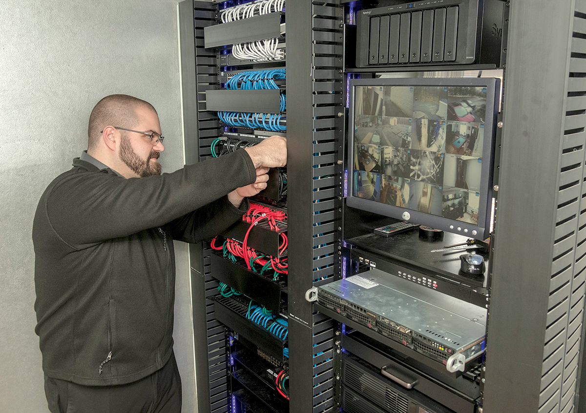 INCREASED DEMAND: Tony Folco is a sales manager at information-technology service company IT Support RI, which is now handling increased demand from clients who are taking their businesses remote. / PBN PHOTO/MICHAEL SALERNO