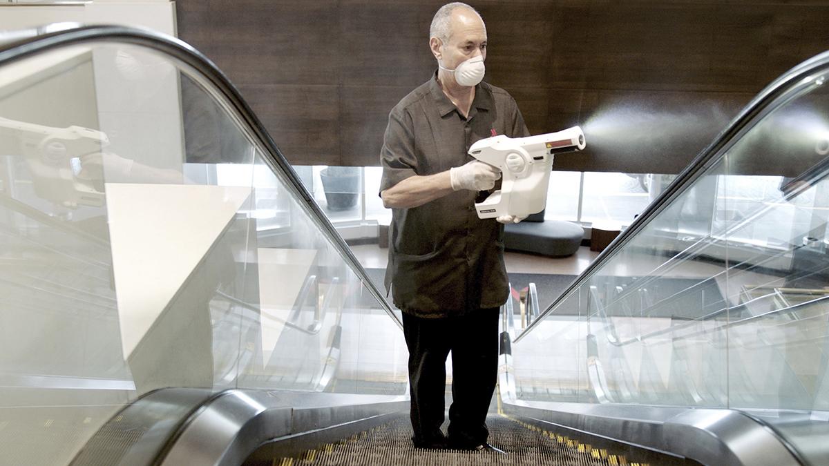 GERM HUNTER: A Marriott associate uses an electrostatic sprayer to clean public areas at the Brooklyn Bridge Marriott in New York in April. / COURTESY MARRIOTT VIA THE ASSOCIATED PRESS